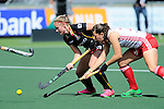 The Hague, Netherlands, June 12: Alix Gerniers #13 of Belgium fights for the ball with Ellie Watton #21 of England during the field hockey placement match (Women - Place 11/12) between Belgium and England on June 12, 2014 during the World Cup 2014 at Kyocera Stadium in The Hague, Netherlands. Final score after full time 1-1 (0-1). Score after shoot-out 1-2  (Photo by Dirk Markgraf / www.265-images.com) *** Local caption ***