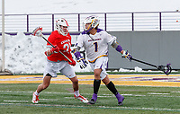University at Albany Men's Lacrosse defeats Cornell 11-9 on Mar 4 at Casey   Tehoka Nanticoke (#1) defended by Fleet Wallace (#25).