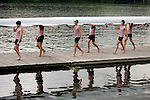 Rowers from Florida Tech carry their boat from the water following a fourth place finish in the Men's Varsity Heavyweight Eight Final during the 68th Dad Vail Regatta on the Schuylkill River in Philadelphia, Pennsylvania on May 13, 2006........