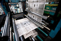 Newspapers are fed through the Dallas Morning News printing press in Plano, Texas, US, Thursday, Dec., 17, 2009. ..MATT NAGER/ BLOOMBERG NEWS