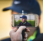 Clare manager Donal Moloney is recorded on a smartphone as he chats with the media following their Munster Hurling League game against Cork at Cusack Park. Photograph by John Kelly.