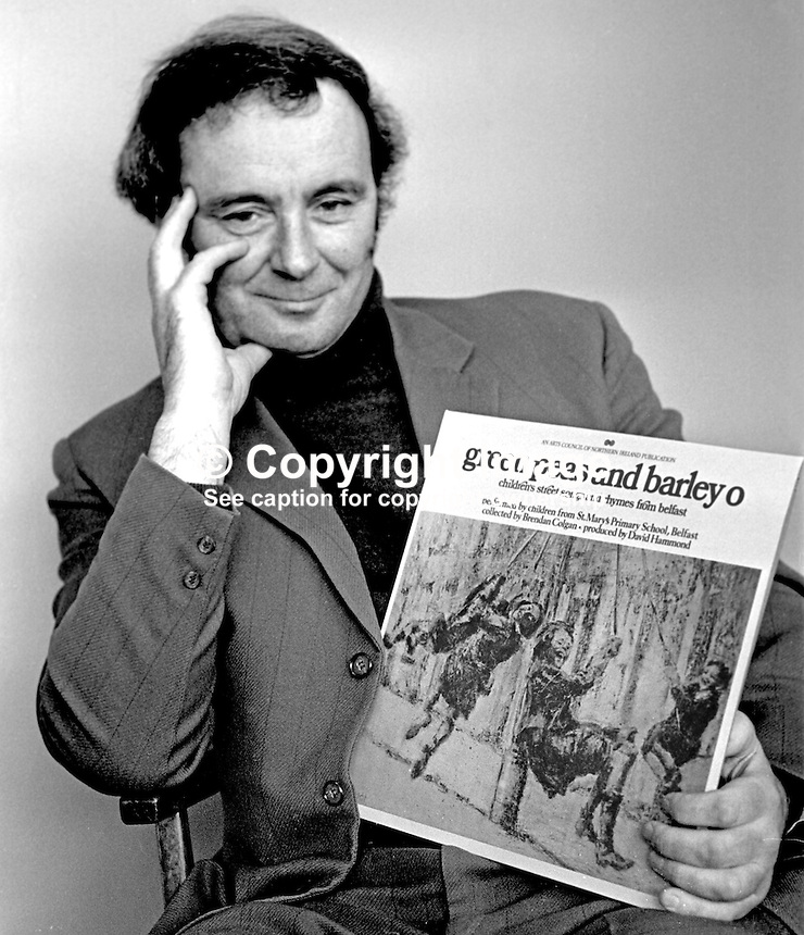 """David Hammond, writer, singer, teacher, songwriter, historian, musician, film-maker, broadcaster, Belfast, N Ireland, with one of his LPs of local street songs titled  """"green peas and barley o"""". 197504000337a..Copyright Image from Victor Patterson, 54 Dorchester Park, Belfast, United Kingdom, UK...For my Terms and Conditions of Use go to http://www.victorpatterson.com/Victor_Patterson/Terms_%26_Conditions.html"""