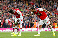 Dani Ceballos wishes Nicolas Pépé of Arsenal luck before his penalty during the Premier League match between Arsenal and Aston Villa at the Emirates Stadium, London, England on 22 September 2019. Photo by Carlton Myrie / PRiME Media Images.
