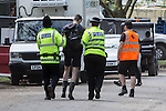 © Joel Goodman - 07973 332324 . 07/06/2015 . Manchester , UK . A festival goer is detained by police at The Parklife 2015 music festival in Heaton Park , Manchester . Photo credit : Joel Goodman