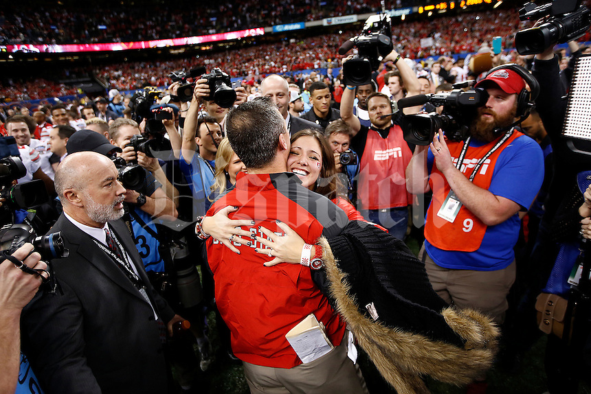 Ohio State Buckeyes head coach Urban Meyer celebrates with his daughter Nicki after the Allstate Sugar Bowl and College Football Playoff Semifinal at Mercedes-Benz Superdome in New Orleans, Friday night, January 2, 2015. The Ohio State Buckeyes defeated the Alabama Crimson Tide 42 - 35. (The Columbus Dispatch / Eamon Queeney)