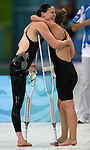 Stephanie Dixon (left) of Victoria, B.C. gets a hug from teammate Brittany Grey of Barrie, Ont. after taking the silver medal in women's 200 metre individual medley, class SM9, in the swimming finals at the Paralympic Games in Beijing, Thursday, Sept., 11, 2008.  Photo by Mike Ridewood/CPC