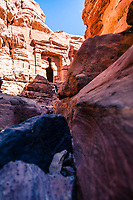 """Solo female hiker explores hidden Petra, Jordan<br /> <br /> This ancient site, established possibly as early as 312 BCE as the capital city of the Nabataeans, it is a symbol of Jordan. It lies on the slope of Jebel al-Madhbah (identified by some as the biblical Mount Hor) in a basin among the mountains which form the eastern flank of Arabah (Wadi Araba), the large valley running from the Dead Sea to the Gulf of Aqaba. Petra has been a UNESCO World Heritage Site since 1985. The site remained unknown to the Western world until 1812, when it was introduced by Swiss explorer Johann Ludwig Burckhardt.<br /> UNESCO has described it as """"one of the most precious cultural properties of man's cultural heritage"""". Petra was named amongst the New 7 Wonders of the World in 2007 and was also chosen by the Smithsonian Magazine as one of the """"28 Places to See Before You Die""""."""