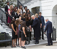 United States President Donald J. Trump and US Vice President Mike Pence pose for photos with 2018 White House Correspondents Association Scholarship Winners at The White House in Washington, DC, April 27, 2018.<br /> Credit: Chris Kleponis / Pool via CNP / MediaPunch