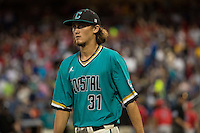 Bobby Holmes #31 of the Coastal Carolina Chanticleers looks on during a College World Series Finals game between the Coastal Carolina Chanticleers and Arizona Wildcats at TD Ameritrade Park on June 27, 2016 in Omaha, Nebraska. (Brace Hemmelgarn/Four Seam Images)