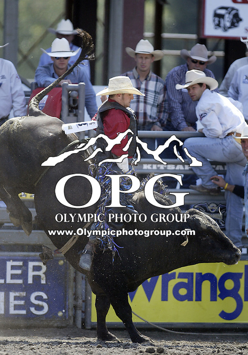30 Aug 2009:  Clint Craig riding the bull Getting Lucky scored a 79 on his ride during the Extreme Bulls tour stop in Bremerton, Washington.  Bremerton was the last stop in the Wrangler Million Dollar Pro Rodeo Silver Tour for 2009.
