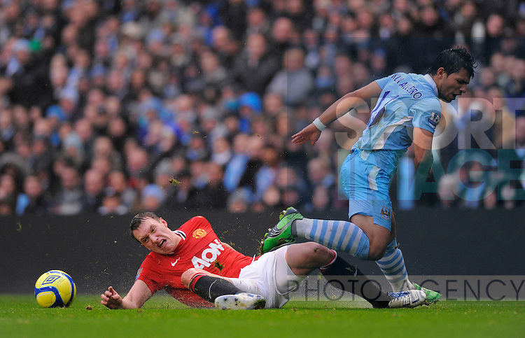 Phil Jones of Manchester United challenged by Sergio Aguero of Manchester City.The FA Cup with Budweiser 3rd Round.Manchester City v Manchester Utd at the Etihad Stadium, Manchester..8th January, 2012.--------------------.Sportimage +44 7980659747.picturedesk@sportimage.co.uk.http://www.sportimage.co.uk/.Editorial use only. Maximum 45 images during a match. No video emulation or promotion as 'live'. No use in games, competitions, merchandise, betting or single club/player services. No use with unofficial audio, video, data, fixtures or club/league logos.