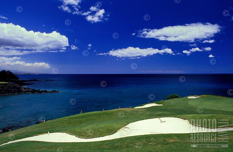 Golf course at the Mauna Kea Beach Hotel with the Big Island coastline