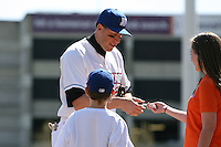 April 14, 2010:  Mike Hessman of the Buffalo Bisons signs an autograph during a game at Coca-Cola Field in Buffalo, New York.  The Bisons are the Triple-A International League affiliate of the New York Mets.  Photo By Mike Janes/Four Seam Images