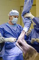 Dr. Tony Rocconi prepares for equine surgery.