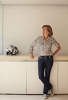 Portrait of Catherine Pawson, the wife of architect John Pawson, standing in their kitchen