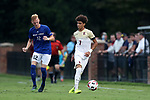 ELON, NC - SEPTEMBER 02: Elon's Elijah Agu (7) and Presbyterian's Kellan O'Hara (12). The Elon University Phoenix hosted the Presbyterian College Blue Hose on September 2, 2017 at Rudd Field in Elon, NC in a Division I college soccer game. Elon won the game 2-0.