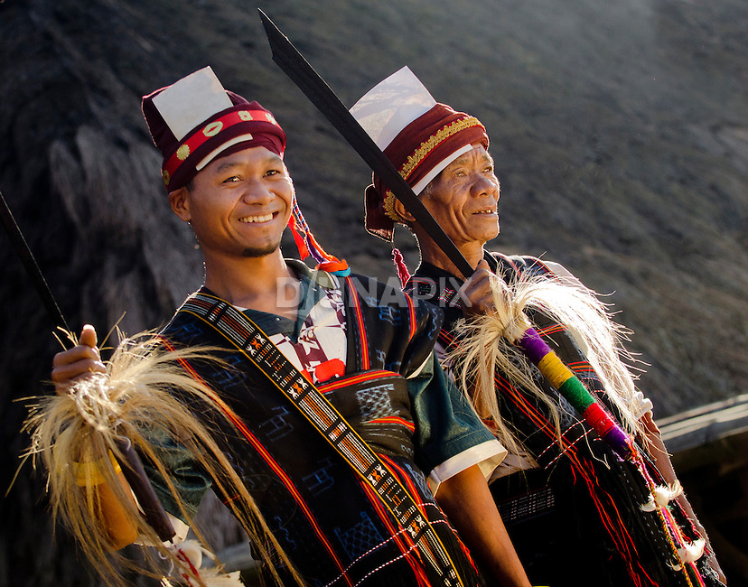 Men in traditional ceremonial dress, Luba Village, near Bajawa, Flores, East Nusa Tenggara, Indonesia