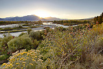 Idaho, Eastern, Swan Valley. SUn Rise over the Snake River Range and the South Fork of the Snake River in autumn.