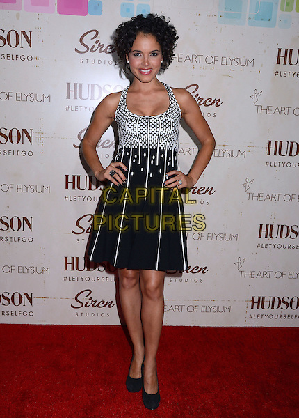Susie Castillo<br /> Celebrity arrivals at The Art of Elysium's fifth annual GENISIS at Siren Studios Cube in Hollywood, CA, USA, 20th September 2013.<br /> full length white print dress hands on hips <br /> CAP/ADM/BT<br /> &copy;Birdie Thompson/AdMedia/Capital Pictures