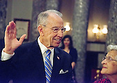 United States Senator Chuck Grassley (Republican of Iowa), takes the oath of office during a mock swearing-in ceremony in the Old US Senate Chamber of the US Capitol in Washington, DC on Tuesday, January 3, 2017.  Grassley's wife, Barbara looks on from right. <br /> Credit: Ron Sachs / CNP<br /> (RESTRICTION: NO New York or New Jersey Newspapers or newspapers within a 75 mile radius of New York City)