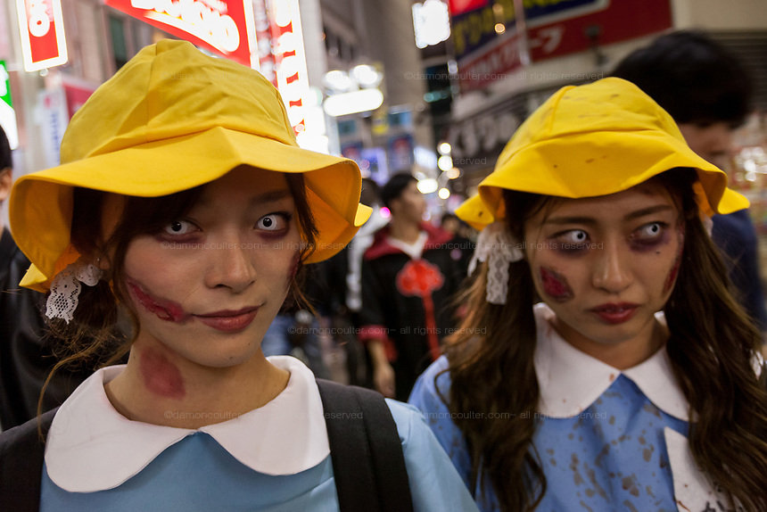 Two Japanese women dressed as elementary school students during the Halloween celebrations Shibuya, Tokyo, Japan. Saturday October 27th 2018. The celebrations marking this event have grown in popularity in Japan recently. Enjoyed mostly by young adults who like to dress up, drink , dance and misbehave in parts of Tokyo like Shibuya and Roppongi. There has been a push back from Japanese society and the police to try to limit the bad behaviour.