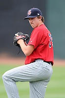 Pitcher Sam Gibbons (35) of the Elizabethton Twins warms up before a game against the Johnson City Cardinals on Sunday, July 27, 2014, at Howard Johnson Field at Cardinal Park in Johnson City, Tennessee. The game was suspended due to weather in the fifth inning. (Tom Priddy/Four Seam Images)