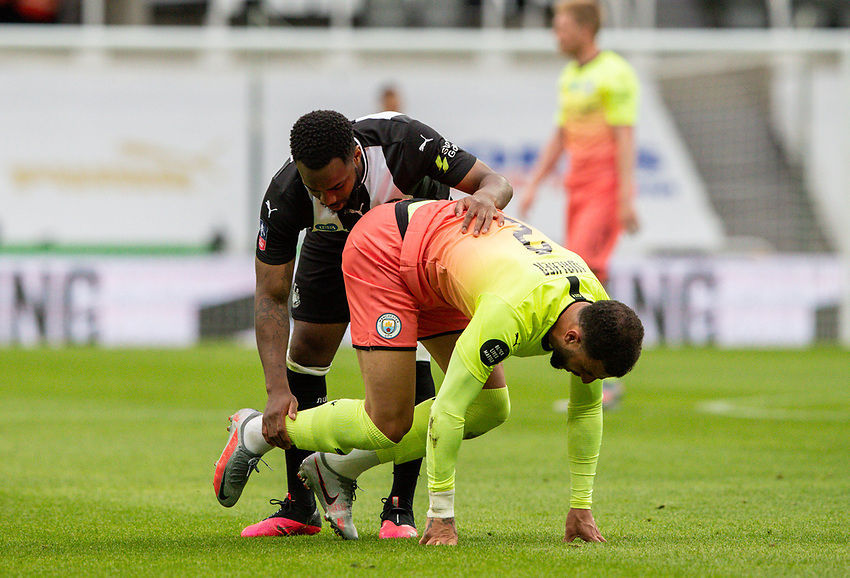 Manchester City's Kyle Walker is helped to his feet by Newcastle United's Danny Rose<br /> <br /> Photographer Alex Dodd/CameraSport<br /> <br /> FA Cup Quarter-Final - Newcastle United v Manchester City - Sunday 28th June 2020 - St James' Park - Newcastle<br />  <br /> World Copyright © 2020 CameraSport. All rights reserved. 43 Linden Ave. Countesthorpe. Leicester. England. LE8 5PG - Tel: +44 (0) 116 277 4147 - admin@camerasport.com - www.camerasport.com