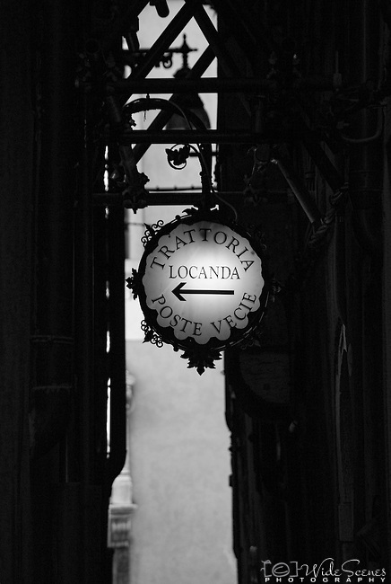 An ornate sign points in the direction of a  prestigious hotel in the sestiere of San Polo in Venice, Italy