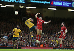 Joe Tomane and Cory Allen compete for the high ball.<br /> Dove Men Series 2014<br /> Wales v Australia<br /> Millennium Stadium<br /> 08.11.14<br /> ©Steve Pope-SPORTINGWALES