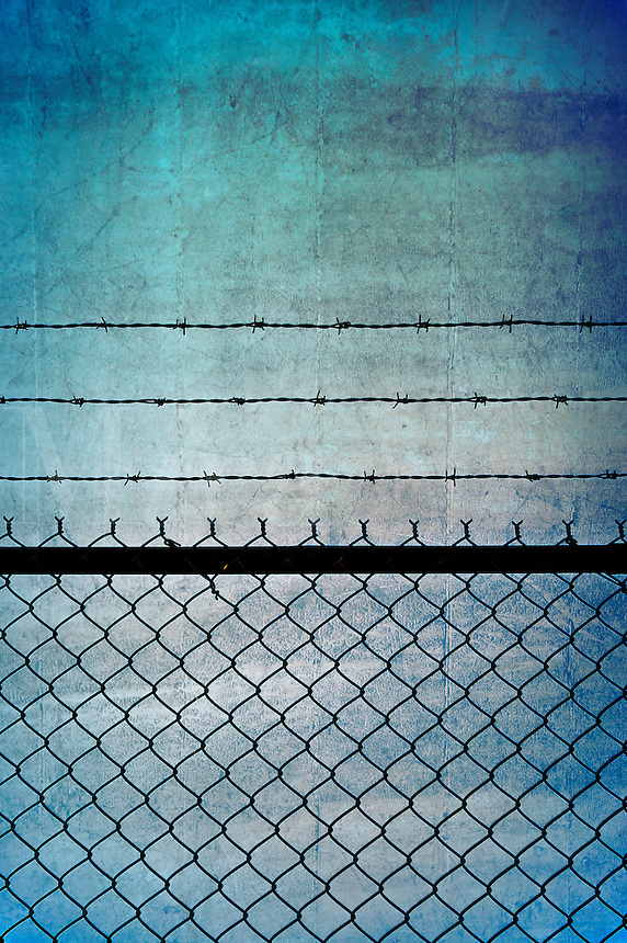 Barbed wire fence.