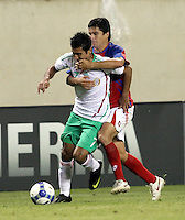 Costa Rica's Christian Olveido (6) wraps up Mexico's Alberto Medina (7).  Mexico defeated Costa Rica 2-1 on penalty kicks in the semifinals of the Gold Cup at Soldier Field in Chicago, IL on July 23, 2009.