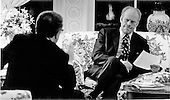 United States President Gerald R. Ford, right, and United States Secretary of State Henry A. Kissinger, left, consider the tough decision to evacuate United States citizens from South Viet Nam at the White House in Washington, D.C. on April 29, 1975.  <br /> Mandatory Credit: David Hume Kennerly / White House via CNP
