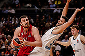 9th February 2018, Wiznik Centre, Madrid, Spain; Euroleague Basketball, Real Madrid versus Olympiacos Piraeus; Nikola Milutinov (OLYMPIACOS BC) breaks away from the defence of Felipe Reyes (Real Madrid Baloncesto)