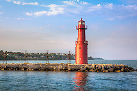 The Algoma Pierhead Lighthouse in Algoma Harbor, Algoma Wisconsin on Lake Michigan.<br /> <br /> The lighthouse was first established in 1893 as a set of range lights. It was rebuilt in 1908 at which time it was a conical tower built of 5/16 inch steel plate, 8 feet in diameter at the base and 7 feet in diameter at the parapet. It stood 26 feet high. In 1932 it was modified again and the entire structure was raised to a height of 42 feet by placing the older tower on a new steel base 12 feet in diameter. The original lens has been replaced by a plastic lens. It is called Algoma Light and listed as number 20975 in the USCG light lists.