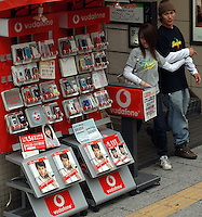 A Vodafone shop in Tokyo, Japan. Vodafone KK, also known as Vodafone Japan and previously as J-Phone, was the Japanese subsidiary company of mobile phone operator Vodafone. On March 17, 2006 Vodafone Group announced it had agreed to sell Vodafone K.K. to SoftBank for approximately 1.75 trillion Japanese yen (approximately US$ 15.1 Billion)..
