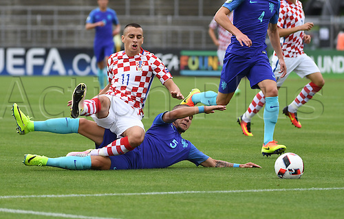 12.07.2016. Donaustadion, Ulm, Germany.  Croatia's Davor Lovren (l-r) and Netherland's Calvin Verdonk in action during the U19 European Soccer Championship Group B preliminary round match between Croatia and the Netherlands at Donaustadion in Ulm, Germany, 12 July 2016.
