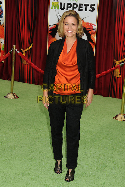 "Cat Cora.""The Muppets"" Los Angeles Premiere held at the El Capitan Theatre, Hollywood, California, USA..November 12th, 2011.full length suit black orange top.CAP/ADM/BP.©Byron Purvis/AdMedia/Capital Pictures."