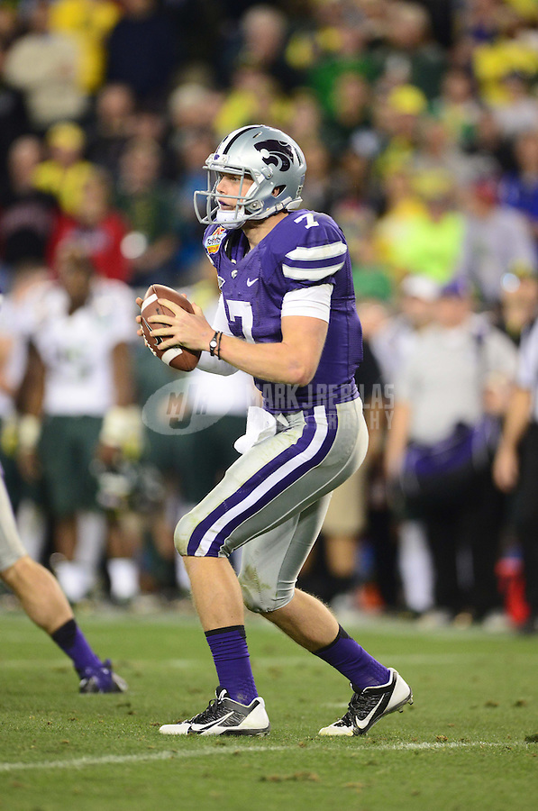 Jan. 3, 2013; Glendale, AZ, USA: Kansas State Wildcats quarterback Collin Klein (7) against the Oregon Ducks during the 2013 Fiesta Bowl at University of Phoenix Stadium. Oregon defeated Kansas State 35-17. Mandatory Credit: Mark J. Rebilas-