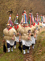 ITUREN, NAVARRE - JANUARY 30: A group of 'Zanpantzar', people dressed in sheep fur and big cowbells tied to their back, march across Ituren village during an ancient traditional carnival on January 30, 2006. Zanpantzar´s march trough Ituren farmhouses and streets sounding their cowbells to wake up the earth for a good new farmer year and keep far away all bad spirits . Photo by Ander Gillenea