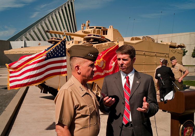 "WASHINGTON, DC - May 4: U.S. Marine Lt. Gen. George J. Flynn, deputy commander for Combat Development and Integration, and Rep. Rob Wittman, R-Va., talk before the ceremony unveiling of the Marines' newest Expeditionary Fighting Vehicle (EFV) prototype. The armored amphibious vehicle is designed carry 17 combatants, plus a three person crew, from Navy ship ""beyond the horizon"" to objectives inland. The ceremony was held at the National Museum of the Marine Corps in Triangle. Va. (Photo by Scott J. Ferrell/Congressional Quarterly)"