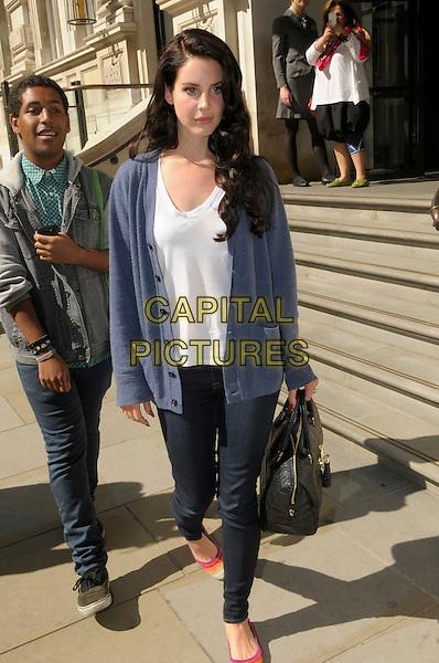 Lana Del Rey leaving her hotel in central London, England..5th September 2012.full length blue cardigan white top jeans denim black bag purse black hair.CAP/IA.©Ian Allis/Capital Pictures.