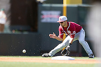 Oklahoma Sooners shortstop Jack Mayfield #8 fields a ground ball against the Texas Longhorns in the NCAA baseball game on April 6, 2013 at UFCU DischFalk Field in Austin, Texas. The Longhorns defeated the rival Sooners 1-0. (Andrew Woolley/Four Seam Images).