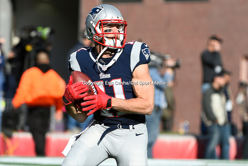 November 23, 2014 - Foxborough, Massachusetts, U.S.- New England Patriots wide receiver Julian Edelman (11) catches a ball prior to the NFL game between the Detroit Lions and the New England Patriots held at Gillette Stadium in Foxborough Massachusetts. The Patriots defeated the Lions 34-9. Eric Canha/CSM