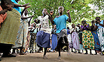 "Women and children sing and dance a song about global climate change in Chidyamanga, a village in southern Malawi that has been hard hit by drought in recent years, leading to chronic food insecurity, especially during the ""hunger season,"" when farmers are waiting for the harvest. ""We are always hungry because of climate change, droughts and floods,"" states the song's chorus. Indeed, climate change has produced dramatic shifts in the area's rains in recent years, creating a real crisis for formers who have long lived from rain-fed crops.agricultural yields."