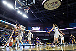 SIOUX FALLS, SD - MARCH 8: Evan Zars #54 of the Western Illinois Leathernecks drives to the basket against Jentry Holt #41 of the Oral Roberts Golden Eagles at the 2020 Summit League Basketball Championship in Sioux Falls, SD. (Photo by Richard Carlson/Inertia)