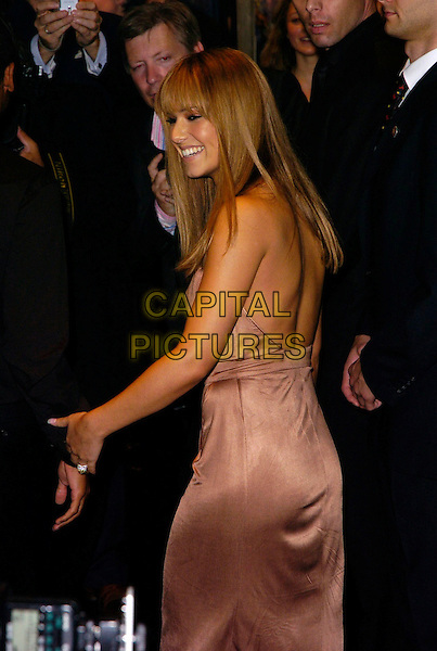 CHERYL COLE.Launch party for the 21st anniversary issue of Elle Magazine at the Versace Store in Sloane Street, London, UK..September 7th, 2006.Ref: CAN.half length brown beige dress looking ove shoulder  Tweedy .www.capitalpictures.com.sales@capitalpictures.com.©Can Nguyen/Capital Pictures.