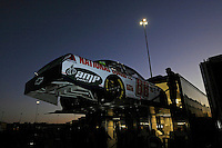the car of Dale Earnhardt,Jr. (#88) is unloaded at daybreak.