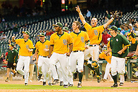 The Baylor Bears celebrate after teammate Max Muncy #9 (not pictured) hit a walk-off home run in the bottom of the 10th inning to defeat the Rice Owls 12-8 at Minute Maid Park on March 6, 2011 in Houston, Texas.  Photo by Brian Westerholt / Four Seam Images