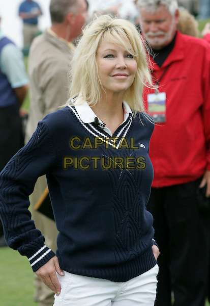 HEATHER LOCKLEAR.The 9th Annual Michael Douglas & Friends Celebrity Golf Tournament held at The Trump National Golf Club in Rancho Palos Verdes, California, USA..April 29th, 2007.sport half length blue sweater jumper .CAP/DVS.©Debbie VanStory/Capital Pictures