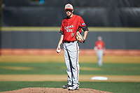 Gardner-Webb Runnin' Bulldogs starting pitcher Landon Mitchell (11) looks to his catcher for the sign against the Wake Forest Demon Deacons at David F. Couch Ballpark on February 18, 2018 in  Winston-Salem, North Carolina. The Demon Deacons defeated the Runnin' Bulldogs 8-4 in game one of a double-header.  (Brian Westerholt/Four Seam Images)